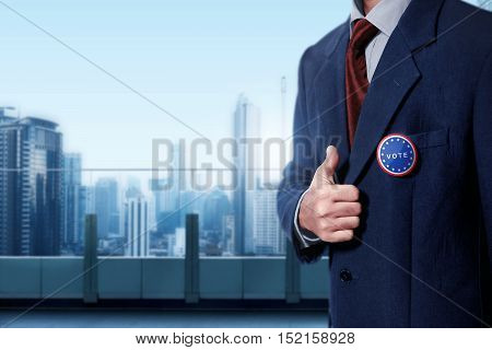 Man With Black Business Suit With Blue Pinned Button Written 'vote'