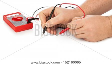 Hands and electric multimeter isolated on white background