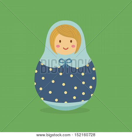 Cute Russian doll with blue polka dot hood and costume on green background.