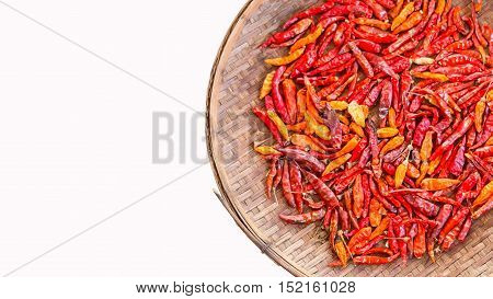 isolated dried chili in threshing basket for food ingredient