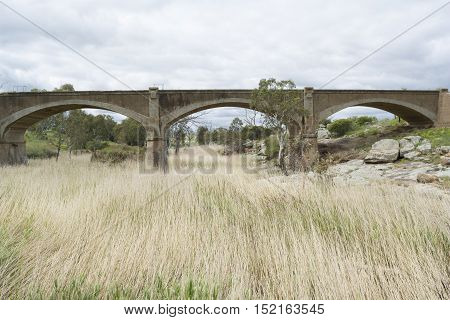Old disused arched railway bridge on Western Boundary Road Palmer near Mannum Waterfalls and part of the Murraylands in South Australia. It crosses over the top of Reedy Creek.