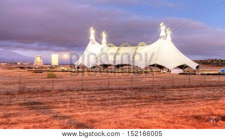 Irvine, California, USA - October 15, 2016: Full moon over a circus tent in a large field near at sunset.