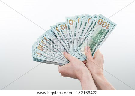 girl believes the dollars in hand on white background