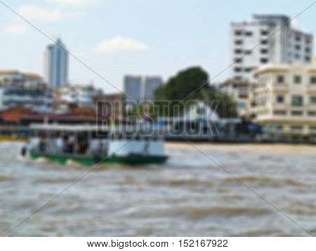 Abstract blur Unidentified people cross Chao Phraya river by ferry boat