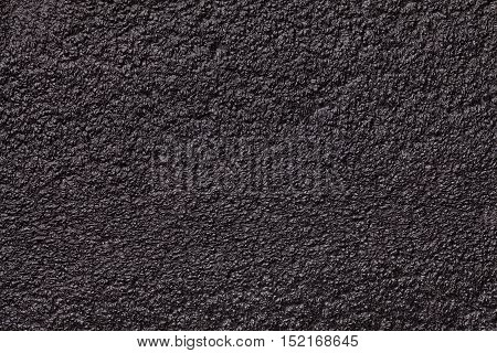 Black glossy background foam closeup. Texture of the rubber construction material macro