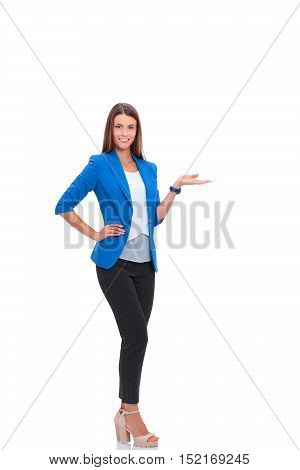 Portrait of young business woman pointing on white background.
