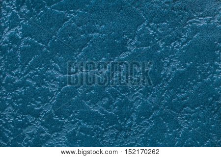 Blue background from a soft upholstery textile material closeup. Fabric with natural texture. Cloth backdrop.