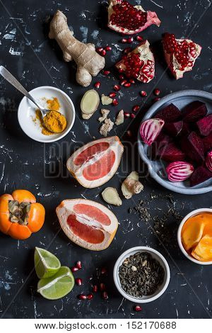 Ingredients for beet and ginger detox elixir. Detox drink. On a dark background top view