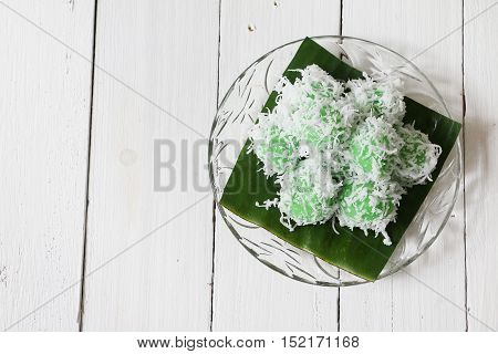 Kuih Ondeh Ondeh or Kelepon, glutinous cake with palm sugar filling