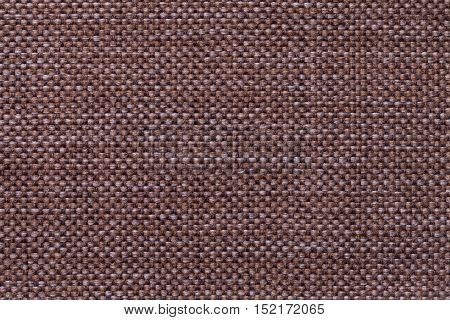 Dark brown background with checkered pattern closeup. Structure of the fabric macro.