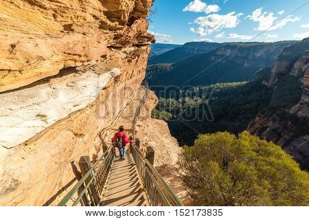 Mountain Landscape With A Woman Hiking, Going Downstairs Mountain Track
