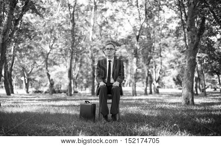 Green Businessman Environmental Conservation Businessman Sitting Concept