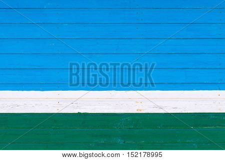 old wooden boards blue green color texture and background and white strip