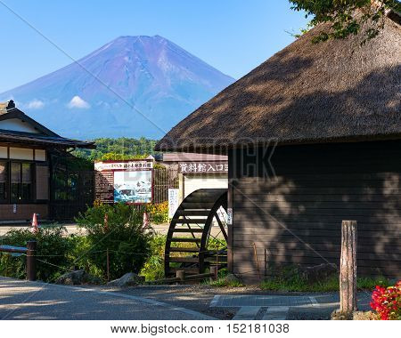 Oshino, Japan - September 2, 2016:Oshino Hakkai, Fuji Five Lakes. Japan countryside street with historic thatch roof farmhouses and Mt Fuji on the background