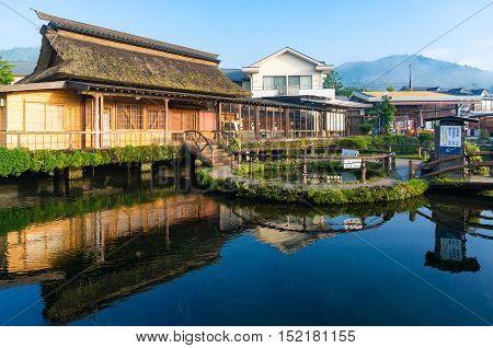 Oshino, Japan - September 2, 2016:Oshino Hakkai Fuji Five Lakes. Japan countryside landscape of traditional thatch roof farmhouses and pond with crystal clear blue water
