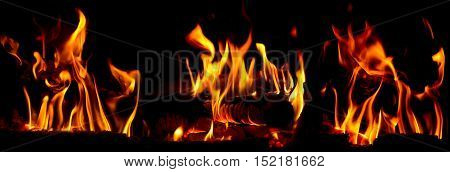 Bonfire flames over black background panoramic view