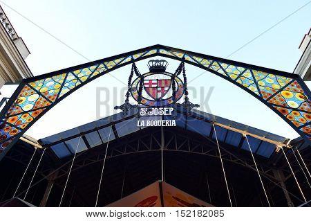 BARCELONA, SPAIN - NOVEMBER 20, 2015: La Boqueria  sign in the daytime. The Mercat de Sant Josep de la Boqueria is a large public market and one of the city's foremost tourist landmark in Barcelona.