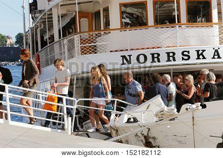 Stockholm, Sweden - August 2, 2013: Passenger leaves Waxholmsbolaget steamer Norrskar that berthed at the Blasieholmen.