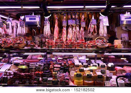 BARCELONA, SPAIN - NOVEMBER 20, 2015: meat displayed at La Boqueria. The Mercat de Sant Josep de la Boqueria is a large public market and one of the city's foremost tourist landmark in Barcelona.
