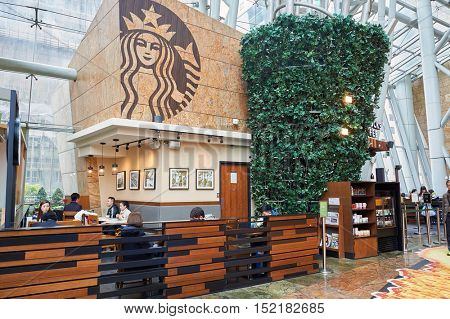 HONG KONG  - 27 JANUARY, 2016: Starbucks in Hong Kong. Starbucks Corporation is an American coffee company and coffeehouse chain