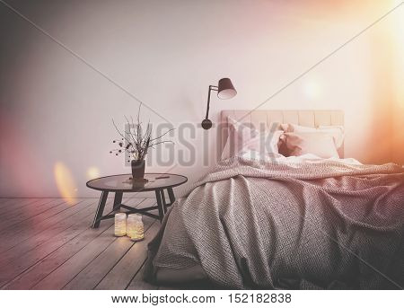 Bright warm sun flare in a messy bedroom with an unmade bed and simple side table on a bare wooden floor. 3d rendering