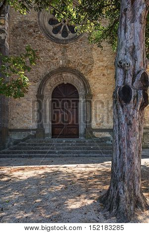 Entrance of the church in the village of Vallon Pont d'Arc, France.