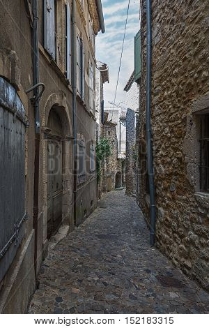 The narrow street in the small French town of Vallon Pont d'Arc, France.