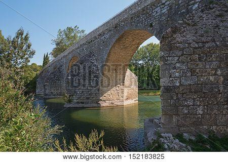 The bridge over the Ceze river near the village of La Roque-sur-Ceze in the Gard department in France.