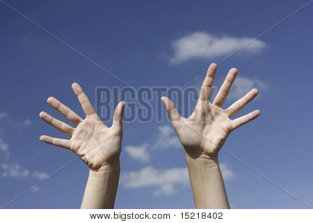 Playful hands and blue sky.