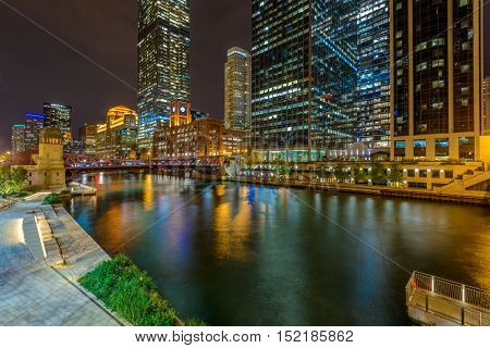 Chicago River skyline with urban skyscrapers at night, IL, USA
