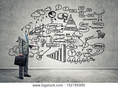 Headless engineer man with papers in hand against sketched background