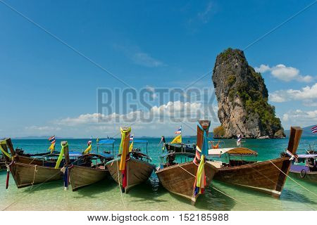 Classical long-tail boats on rock background. Thailand.