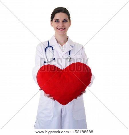 Smiling female doctor assistant in white coat over white isolated background with stethoscope and plush toy heart, healthcare, profession and medicine concept