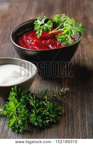 Traditional Beetroot Soup In A Brown Plate With Temyan, Sour Cre