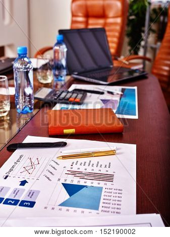 Business interior on table with laptop and leather chair in office.