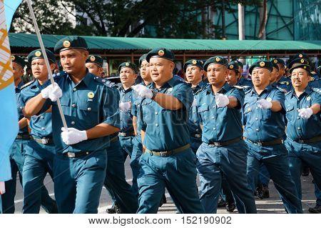 Kota Kinabalu,Sabah:Aug 31,2016:Malaysia National Day Parade.A marching platoon from the Sabah Forestry Department on 31st Aug 2016 at Kota KInabalu,Sabah,Borneo.
