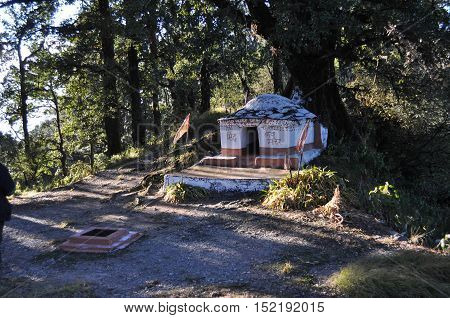 November 11 2015: A small temple of Chenna Baba at the highest Cheena peak of Nainital, Uttarakhand, India.  Dreamland Nainital is a popular hill station in the Indian state of Uttarakhand in the Kumaon foothills of the outer Himalayas named after the God