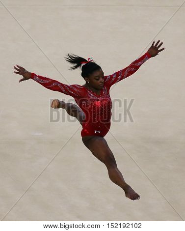RIO DE JANEIRO, BRAZIL - AUGUST 4, 2016: Olympic champion Simone Biles of United States during an artistic gymnastics floor exercise training session for Rio 2016 Olympics at the Rio Olympic Arena