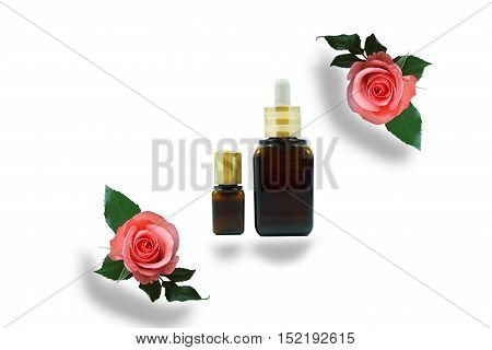 Moisturizing serum for dry skin and roses on isolate background.