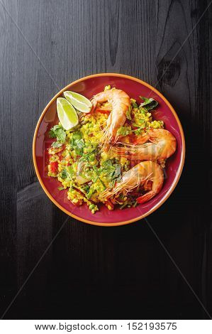 Spanish Paella With Seafood On The Red Teralke With Lime. Delici
