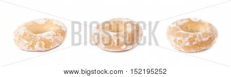 Set of sushki round small dried cakes with hole with sugar powder isolated over the white background