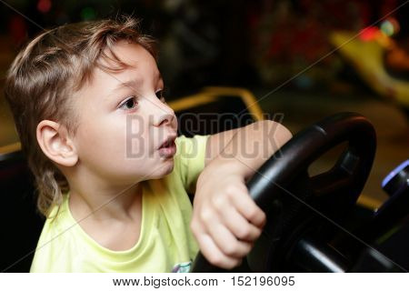 Child Driving A Car Simulator