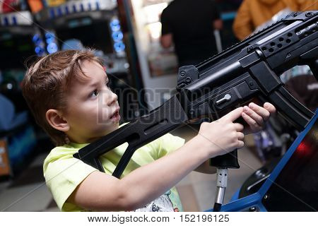 Child Shooting A Rifle
