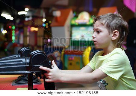 Kid Shooting A Gun