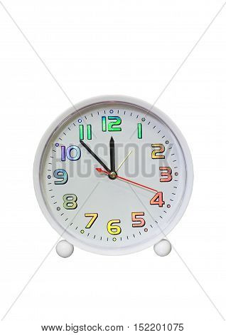 New year comes! Alarm clock on a white background