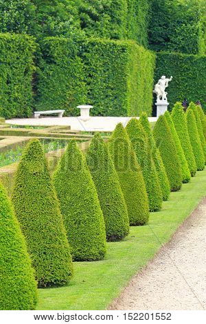 Statue on a path of Versailles garden Paris France