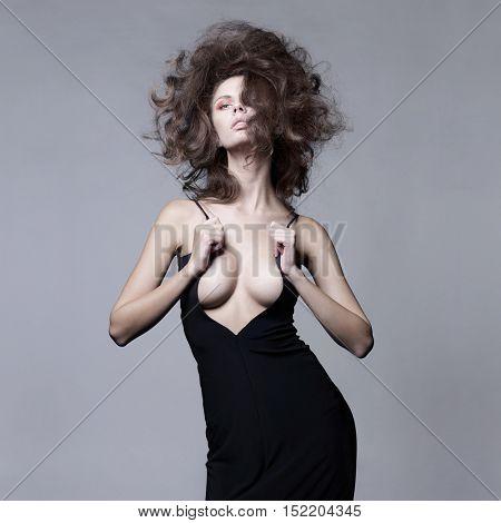 Studio fashion portrait of beautiful sensual woman with volume wavy hair. Big hair