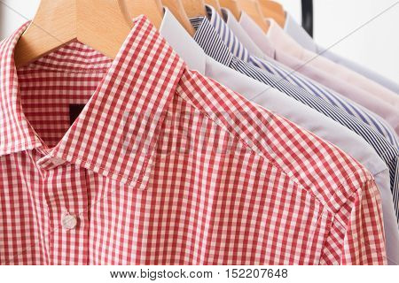 Shirts in several different colors and textures