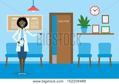Doctor in waiting room. Beautiful smiling african american woman in white standing in waiting room. Hospital interior with chairs and health care information.