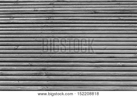old wooden shafts or corrugated texture of uneven background of gray color